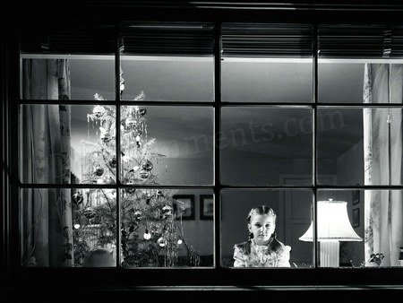 Picture: Girl standing next to christmas tree