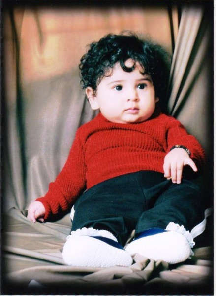 Cute Baby With Curly Hairs