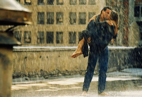 Lovers kissing in rain
