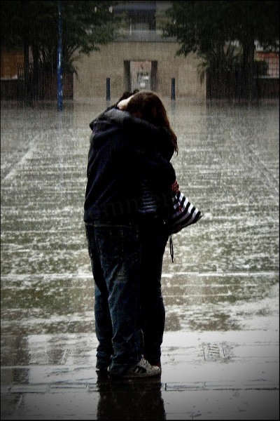 Couple hugging in the rain