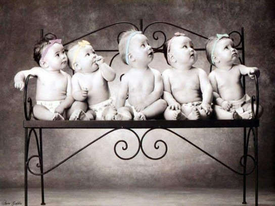 Babies sitting on bench
