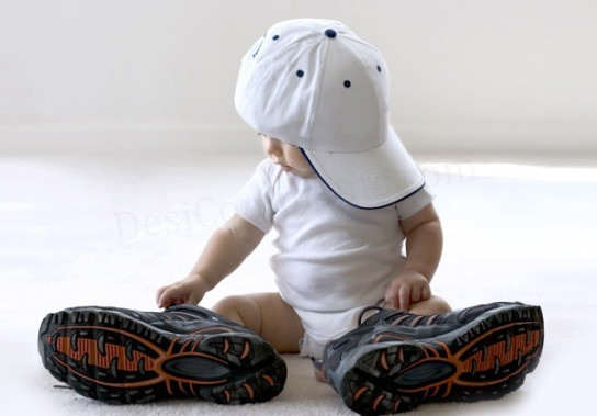 Baby with big cap and big shoes