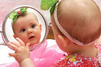 Baby looking in the mirror