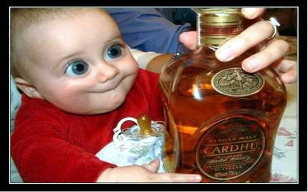 Funny Baby With Bottle of Alcohol
