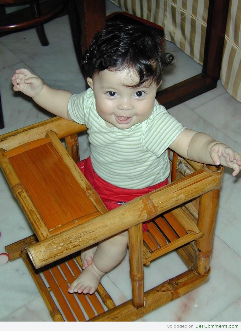 Baby sitting on chair for Toddler sitting chair