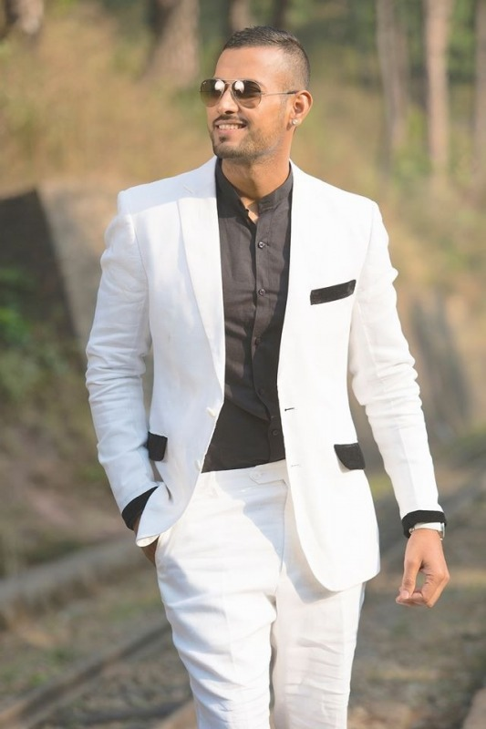Picture: Garry Sandhu in White Pant Coat