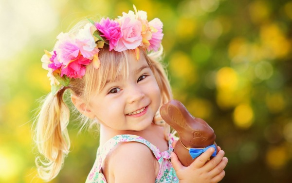 Little Girl With A Tiara Made Of Flowers