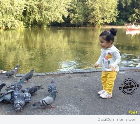 Beautiful baby with Pigeons