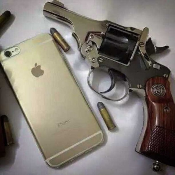 Apple I Phone And Revolver