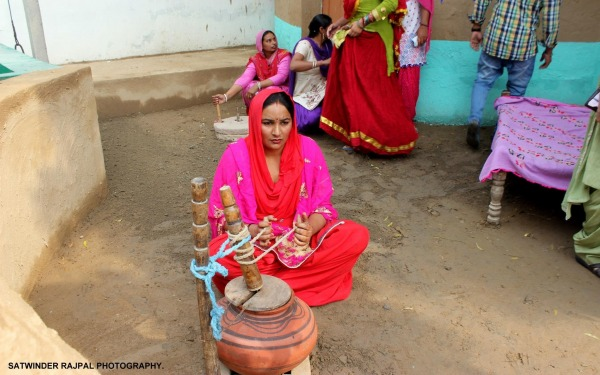 Woman Making Lassi (Drink Of Punjab)