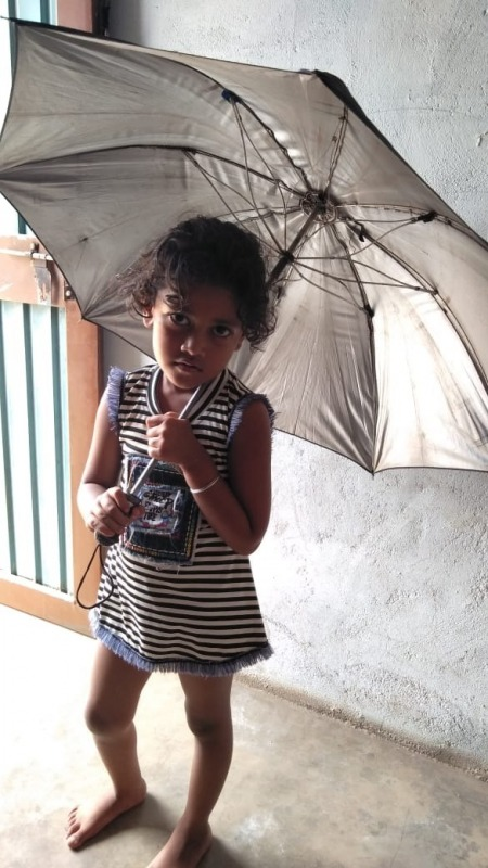 Cute Little Girl Holding Umbrella
