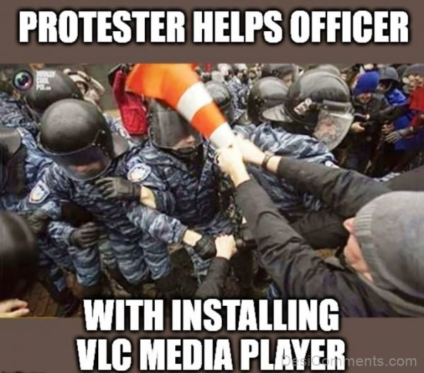Protester Helps Officer