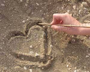 Picture: Drawing Heart On Sand