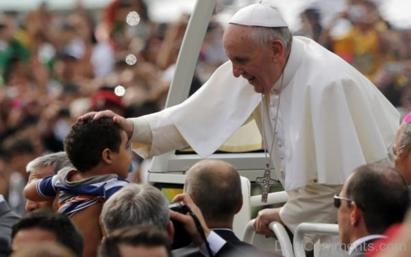 Pope Francis Blesses A Child During The World Youth Day
