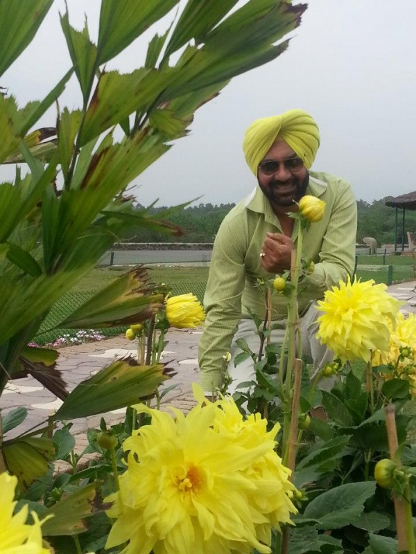Pammi Bai Giving A Pose With Flowers