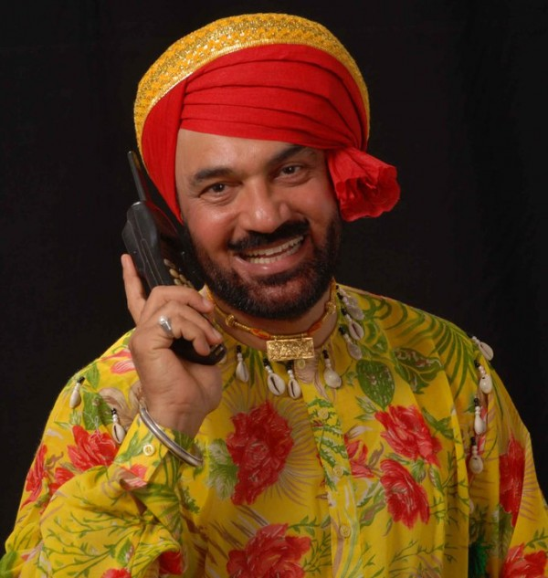 Pammi Bai Giving A Pose With Phone