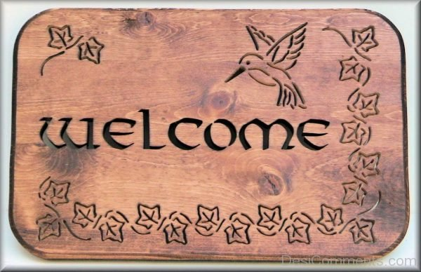 Welcome On Wooden Board